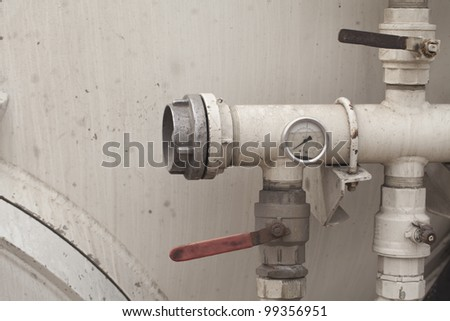 metal tube with a manometer - stock photo