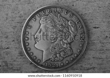 metal us dollar 1921 on wooden background