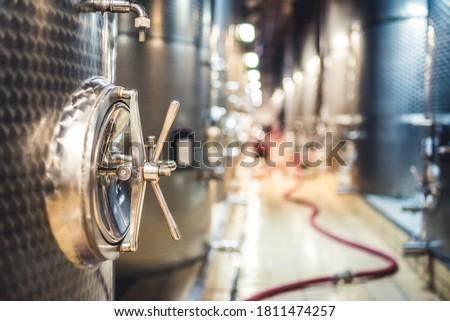 Metal vats for fermentation. Wine factory. Steel barrels in winery. Foto stock ©