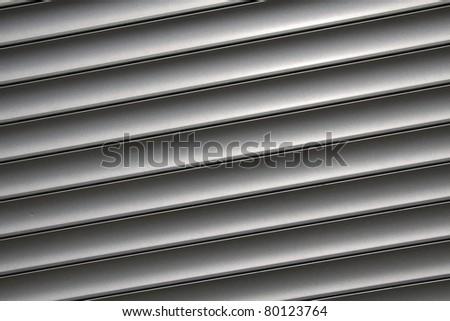 Metal window blinds as stripe pattern