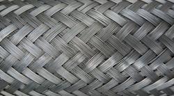 Metal wire braiding. Steel texture. Background.