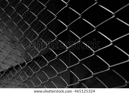 Metal wire fence or cage with blur background. Abstract background #465125324