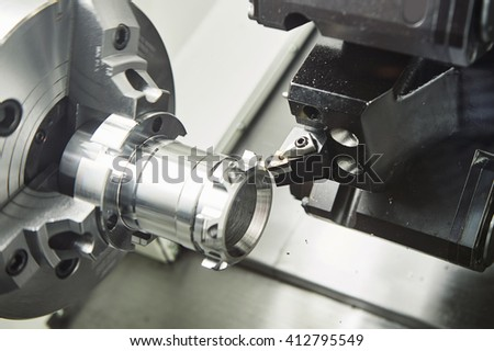 metal working. cutting tool pefroming turning operation at cnc machine #412795549