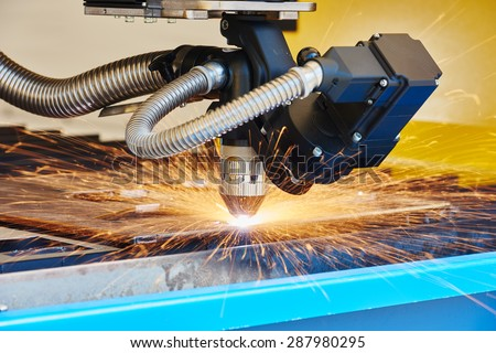 metal working. Plasma or Laser cutting technology of flat sheet metal steel material with sparks #287980295