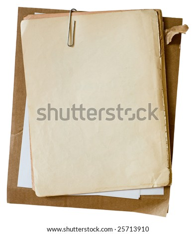 Metalic paper clip on stack of old papers. Clipping path included