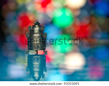 metallic asian bell on a colorful blurry lights background