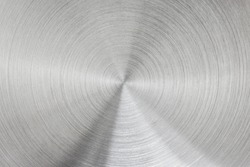Metallic background of brushed chrome stainless steel surface with circular shapes.