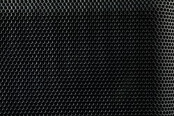 Metallic background with perforation of round holes. Black metal texture with round holes.