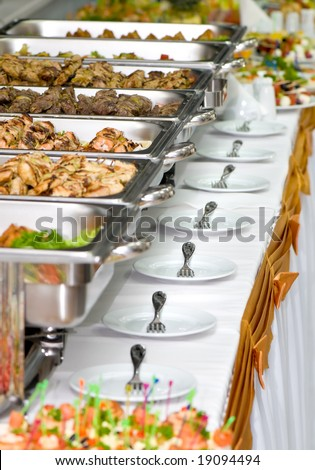 metallic banquet meal trays served on tables