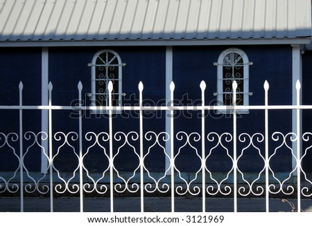 Metallic fence beside the church - stock photo