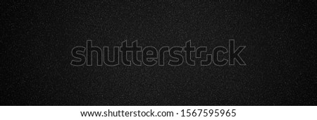 Metallic glitter black texture background, close up  banner. Noisy black backdrop. Panoramic black metal background. Foto d'archivio ©