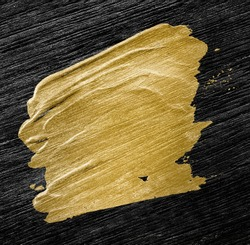 Metallic gold oil paint brush stroke texture on a black background
