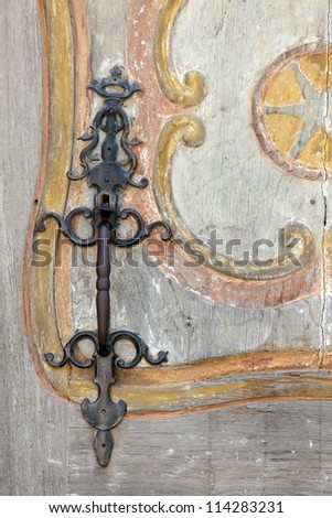 metallic  handle on old wooden door