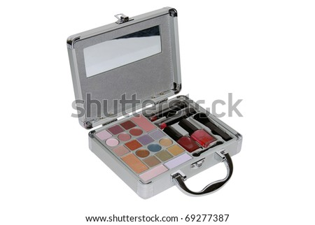 metallic makeup case with some colors, lipsticks and brushes