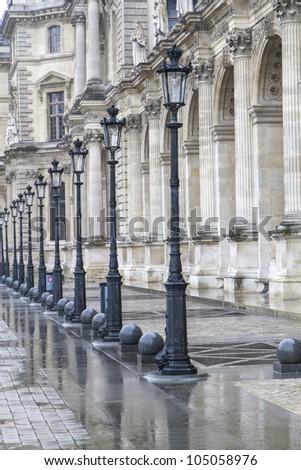Metallic retro lampposts in historic Paris, France - stock photo