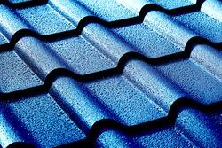 Metallic roof with drops of water. Macro image.