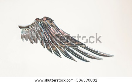 Metallic silver angel wing.Freedom fairy symbol.Isolated on white background