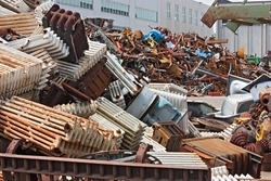 metallic waste storage for recycling - old heating radiators of cast iron and other metals refuse
