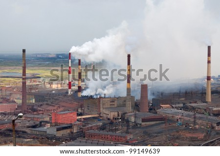Metallurgical plant polluting the atmosphere with sulfur dioxide. Metallurgical plant of nickel, one of the oldest, built in the thirties of last century.