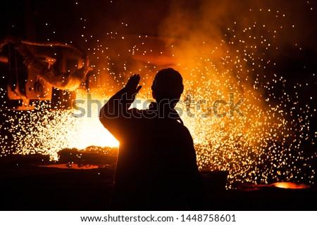 Metallurgist at casting ingot. Foundry Shop, Metallurgical production.
