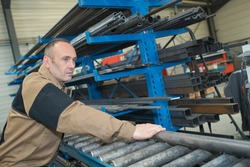metallurgy engineer holding steel pipes