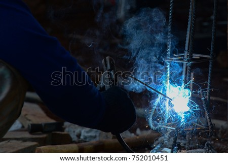 Welding work - welding steel with spread spark lighting smoke Images
