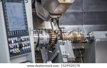 Metalworking CNC lathe milling machine. Cutting metal modern processing technology. Milling is the process of machining using rotary cutters to remove material by advancing a cutter into a workpiece. #1529920178