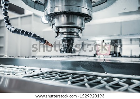 Metalworking CNC lathe milling machine. Cutting metal modern processing technology. Milling is the process of machining using rotary cutters to remove material by advancing a cutter into a workpiece. #1529920193