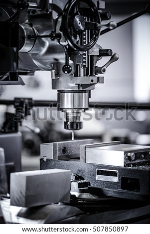 Metalworking CNC milling machine. Cutting metal modern processing technology. Small depth of field. Warning - authentic shooting in challenging conditions. A little bit grain and maybe blurred. #507850897