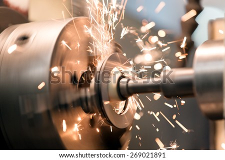 metalworking industry: finishing metal working internal steel surface on lathe grinder machine with flying sparks Stockfoto ©