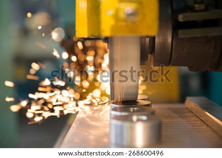 metalworking industry: finishing metal working on horizontal surface grinder machine with flying sparks