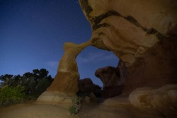 Metate arch during astronomical twilight in Devils Garden Utah