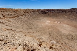 Meteor Crater is a meteorite impact crater approximately 37 miles  east of Flagstaff and 18 miles west of Winslow in the northern Arizona desert