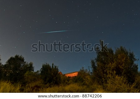 Meteor crossing the sky - stock photo