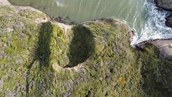 Meteor impact like hole spotted in wharariki beach newzealand.