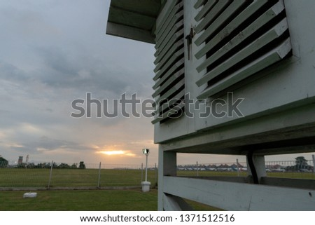 Meteorological cage under the grey cloudy sky. Meteorological cage is a place to put the meteorological tools like thermometer maximum, minimum, web bulb, dry bulb and etc. #1371512516