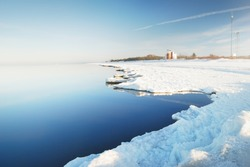 Meteorological station on the frozen sea shore on a clear day. Concept winter scene. Meteorology, science, ecological issues, environmental conservation, global warming, climate change
