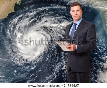 Meteorologist forecasting hurricane