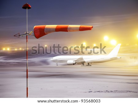 Meteorology windsock inflated by wind in airport at  non-flying night