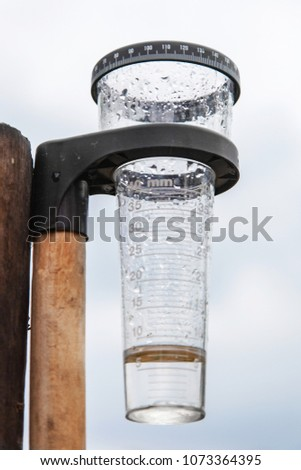 Meteorology with rain gauge in garden, measurement of precipitation #1073364395