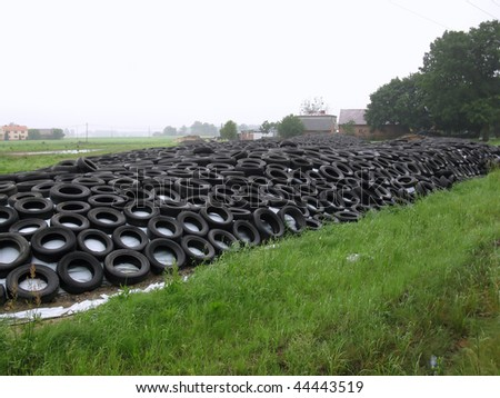 Method of preparation of silage by farmers using old tires as a burden - stock photo