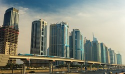 Metro line going through Dubai Marina with modern skyscrapers around,Dubai,United Arab Emirates