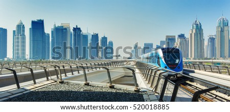 Metro railway and fully automated train in modern and luxury Dubai city,United Arab Emirates