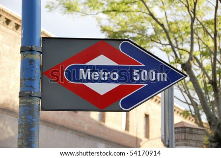 Metro sign in Madrid, Spain. Subway is near. 500 m