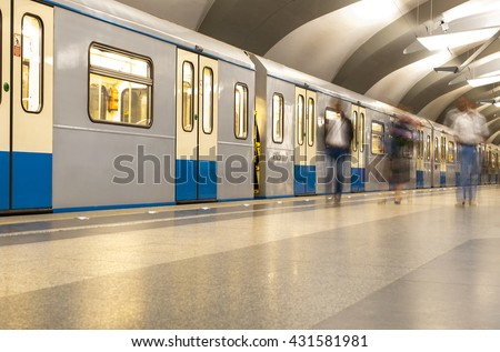 Metro station with passengers