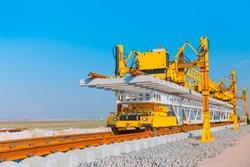 Metro (train) construction site, railroad track installation machine is in use