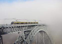 Metro Train on the Bridge Built by Eiffel in Porto, foggy morning