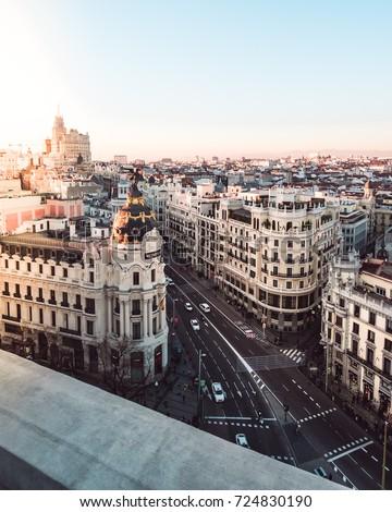 Metropolis building in Gran Via. Madrid at sunset (Spain) #724830190