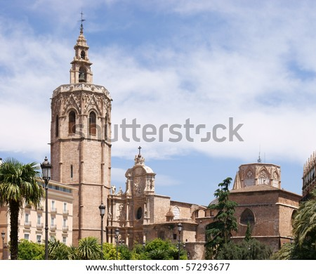 "Metropolitan Basilica Cathedral of Saint Mary in Valencia with the bell tower ""El Miguelete"". The Cathedral is also know as the Cathedral of the Holy Chalice. View from Plaza de la Reina."