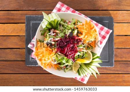 Mevsim salata is turkish season salad which is serving on wood table background. Stok fotoğraf ©